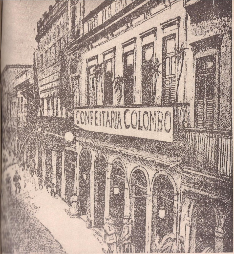 A gravura, reprodução de um desenho de Henrique Cavalleiro, do comêço do século, mostra o antigo prédio ns. 34/36 da rua Gonçalves Dias, constituído de loja e sobrado.